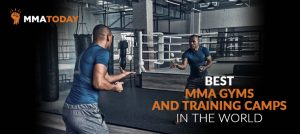 Man in mixed martial arts gym doing exercises.