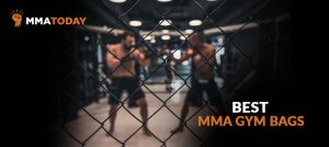 Men fighting in mma gym cage.