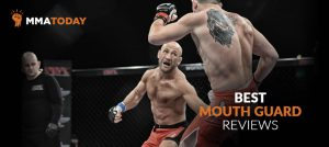 Man fighting mma with mouth guard showing.