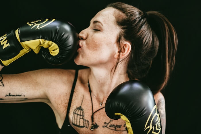 Lady kissing her MMA muay thai gloves